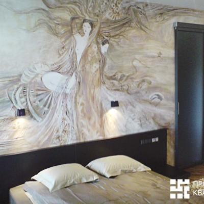 Ремонт квартиры на Дрезденской. Спальня. Розетки и выключатели встроены в спинку кровати. Дверь-купе ведёт в гардеробную